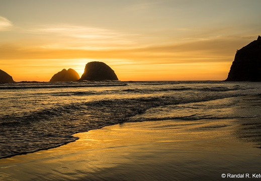 Sea Stacks at Oceanside, Setting Sun, Wispy Clouds, Golden Sand